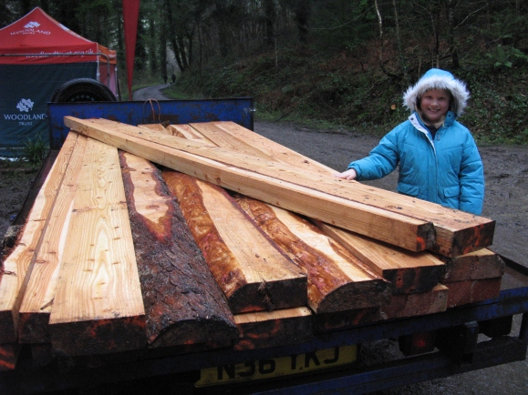 Laura inspects the timber for new raised beds at Okehampton Primary School